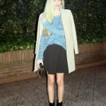 Camel coat and black skirt
